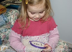 Teach your preschooler to sew using a piece of rubber grip pad, embroidery hoop, plastic needle and yarn
